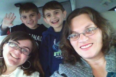 Mom and 3 kids in a minivan