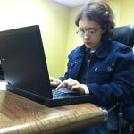 Emily on computer at school