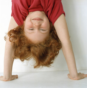 Little Girl Doing Handstand --- Image by © Royalty-Free/Corbis